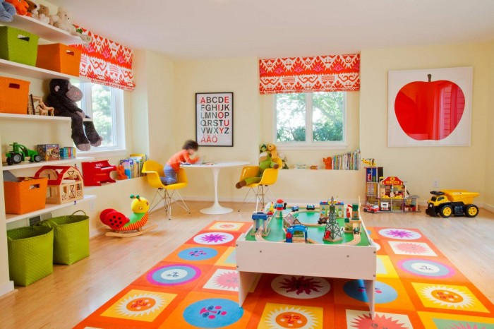 Geometric-and-floral-mat-in-brightly-colored-childs-playroom-700x466