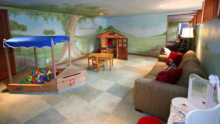 Magical-hillside-childs-playroom-with-adult-spaces-and-tree-mural-700x397