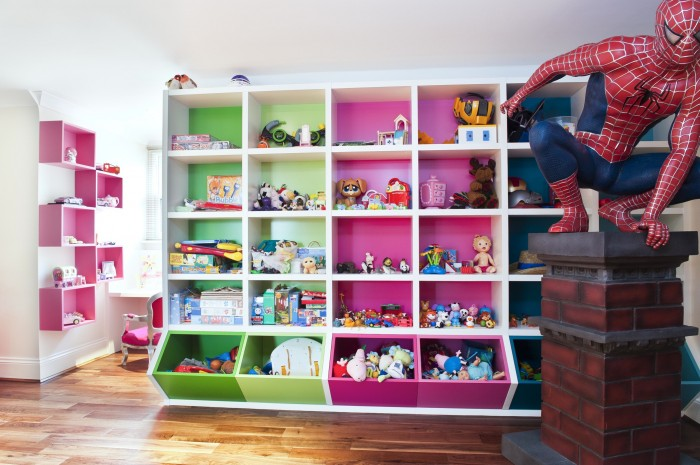 white-Attic-stule-childsroom-with-pink-and-green-storage-cubes-and-spiderman-700x465