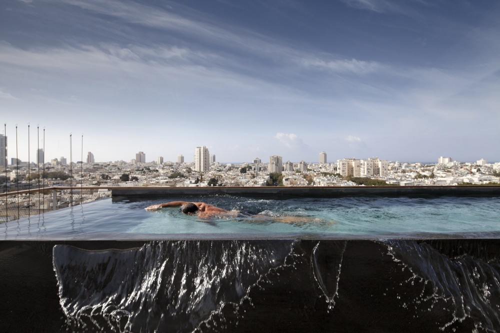 53aa1290c07a8037b3000039_open-and-transparent-to-the-city-pitsou-kedem-architects_rachel_yanai_007-1000x666