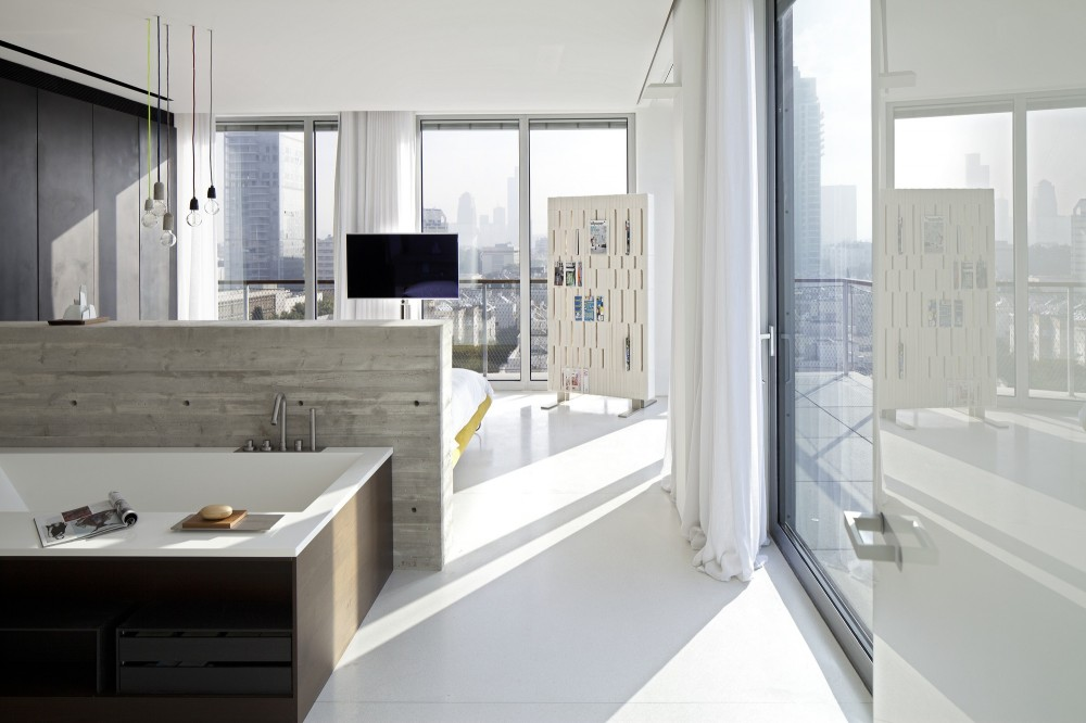 53aa12c5c07a8033bd000038_open-and-transparent-to-the-city-pitsou-kedem-architects_rachel_yanai_024-1000x666