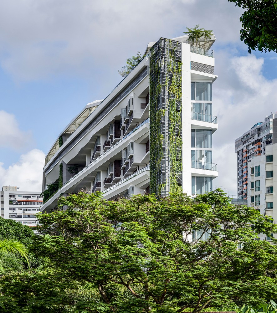 54bef970e58eceef7000015a_jardin-dp-architects_portada_jardin-the-development-emerging-out-of-a-nestle-of-green-and-foliage-885x1000