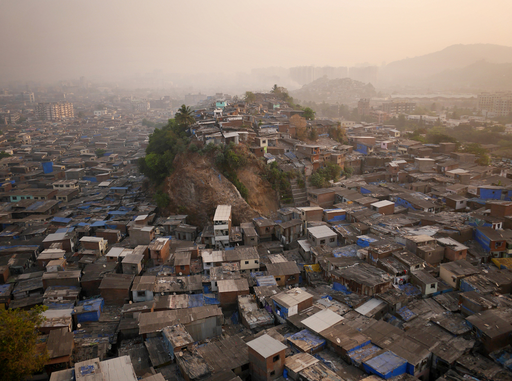 "Morning over Maximum City.   Known to the locals as ""Hill 3"" this knoll jutting above Mumbai's northern slums is no more valuable than the land below. Access to running water, which the hill lacks, is far more valuable than any view."