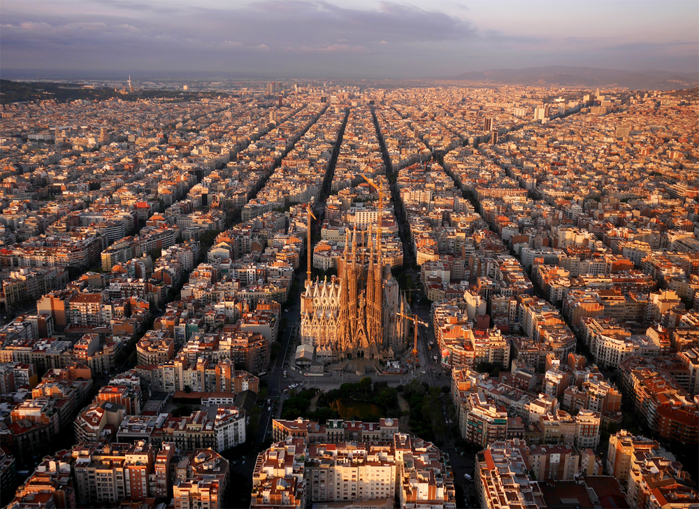 "The ""Eixample"" district of Barcelona, with Sagrada Familia. The octagonal city blocks were designed to allow light and space on the street corners."
