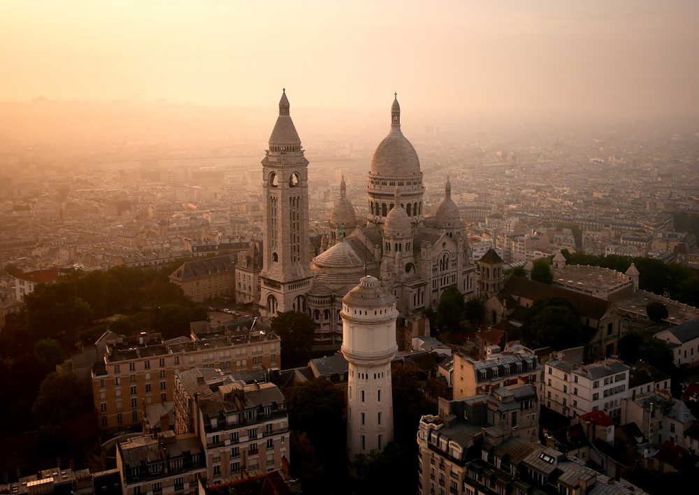 Paris' Sacré-Cœur glowing in a hazy sunrise.
