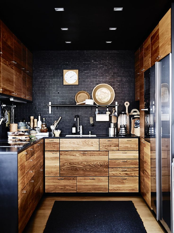 Black-small-tiles-and-wood-cupboards